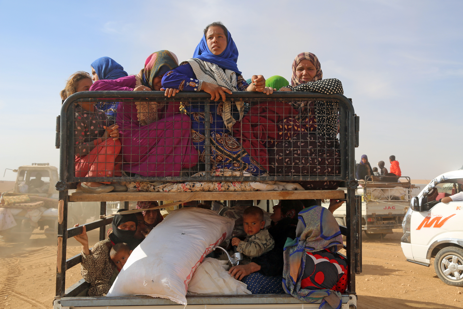 Displaced children and adults are seen in a vehicle after fleeing from ISIL- controlled areas in rural Raqqa in Syria. Photo Credit: UNICEF