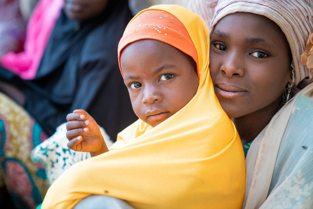 On 13 March 2020 in Fanisau Ugongo Village, Kano State, Nigeria, Fatima (right), 13, and her sister, Amina, 3, with their mother (not pictured), take part in a community meeting of local women lead by Volunteer Community Mobilizer (VCM) Laira Dauda (not pictured). VCMs are a vital relay in communicating vital public health messaging. Approximately 18,000 VCMs, over 90 prevent of whom are women, are at the centre of Nigeria's polio eradication programme. Supported by UNICEF, they are from the local community and are trusted by parents and caregivers on information related to vaccines and other health practices for their well-being of their children. VCMs have also built critical relationships with traditional leaders, religious clerics and other local influencers to build trust in polio and other vaccines in the community. Nigeria has crossed over three years without a single child being paralyzed by the wild polio virus and is on track to be certified wild polio virus free along with the African region in 2020. However, the government and GPEI partners continue supporting efforts to immunize the country's 55.5 million children under five years of age to maintain the 'zero polio case' status and rid the country of all forms of the polio virus.