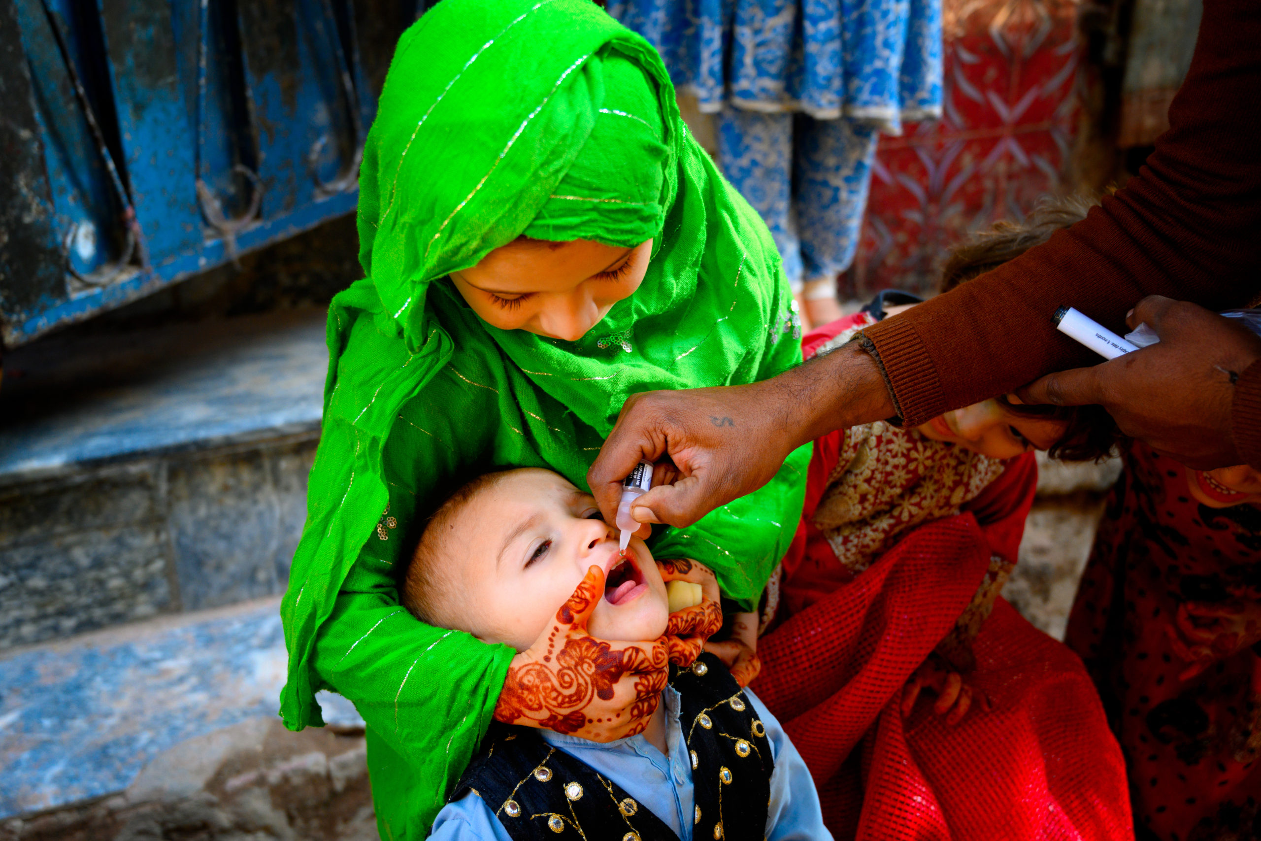 Sister with brother polio vaccination