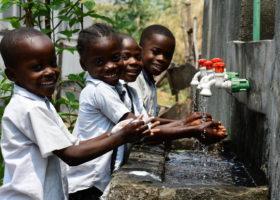 Children washing their hands at their school